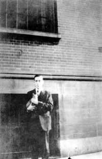 H.P. Lovecraft holding Frank Belknap Long's cat. Photo via The Great Cat